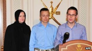 An Austrian student (right) and a Finnish couple abducted in Yemen by Al-Qaeda militants talk to local media