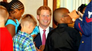 Prince Harry with children on the first day of his US tour.