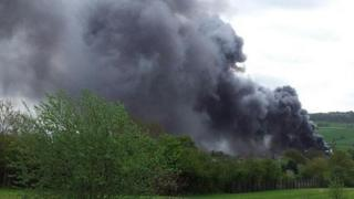Thick black smoke clouds above Belpher.