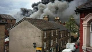 Smoke billows over the rooftops in Belper
