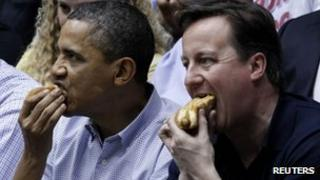 Barack Obama and David Cameron eat hot dogs at a basketball match - 13 March 2012