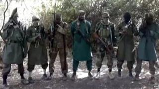 A picture taken from a video distributed to Nigerian journalists in the country's north and obtained by AFP on March 5, 2013 reportedly shows Abubakar Shekau (C), the suspected leader of Nigerian Islamist group Boko Haram