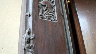 Carvings of a lizard and a helmet at Central fire station