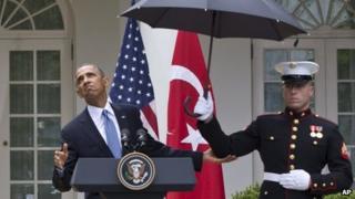 Marines hold up umbrellas for Turkish Prime Minister Tayyip Erdogan (left) and US President Barack Obama in Washington DC 16 May 2013