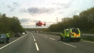 A helicopter on the M4 near Cardiff after a car overturned near junction 33