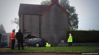 The house in Washingborough with a car in the wall