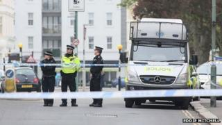 Police officers near the scene of the shooting in Hove