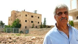 Ali Ayyad stands close to the Cliff Hotel