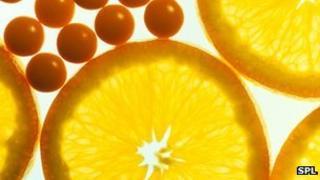 vitamin C tablets and orange slices