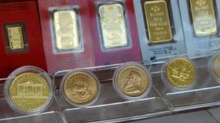 Gold coins and bars on display