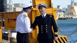 Commander Irvine Lindsay disembarks