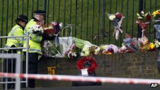 Police carry floral tributes