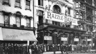 Exterior view of crowds queuing outside the Empire Theatre, Leicester Square to see Razzle Dazzle, 1917