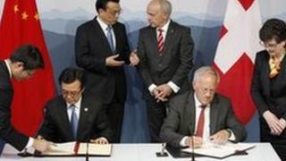 Chinese secretary of trade and Swiss economy minister sign memorandum of understanding of free trade on 24 May
