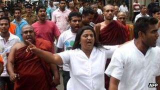 Dozens of people protested after the authorities rejected a state funeral for the monk