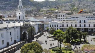 Quito's Plaza Grande square with its Spanish colonial architecture is dominated by the presidential palace, Ecuador's flag fluttering above