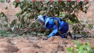 A volunteer de-miner works on 10 May 10 2008 at a site in Ziguinchor, Senegal