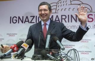 Centre-left candidate Ignazio Marino waves at a meeting in Rome, 27 May