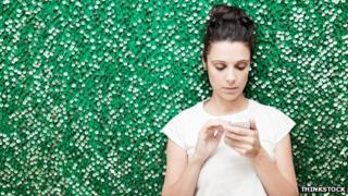 Woman looks at social media on smartphone