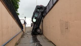 car in pedestrian underpass