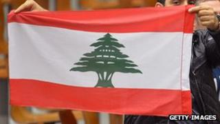 Man waves Lebanese flag