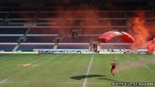 A Red Devil parachutist lands on Welford Road