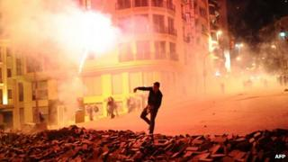 Protestors clash with Turkish riot policemen near Taksim Square in Istanbul