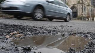 Car passing pothole