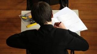 Schoolboy taking exam (generic)