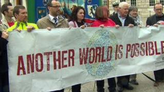 Banner reading another world possible