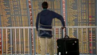 A passenger checks a board on 11 June 2013 at Roissy-Charles de Gaulle international airport