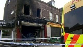 The fire-damaged shop