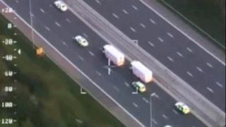 Aerial shot of police convoy to Dale Cregan trial