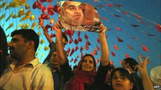 Iranian supporters of presidential candidate Hassan Rouhani celebrate in Tehran
