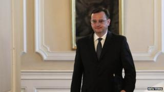 Czech Prime Minister Petr Necas arrives to tender his resignation (17 June)