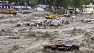 Vehicles drifting in a flooded river in Uttarkashi district, India.