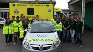 Medical students with their emergency response vehicles