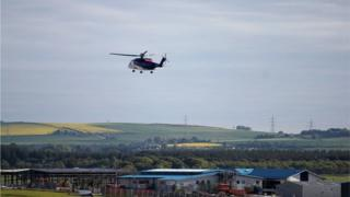 Oil workers arriving at Aberdeen are flown to the off shore oil rigs by helicopter