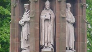 A monument to the translators of the Bible stands in the grounds of St Asaph Cathedral