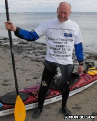 Simon Beeson next to his kayak