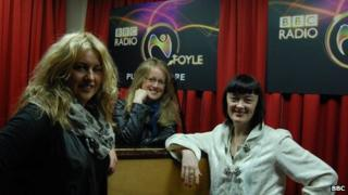 BBC Radio Foyle's Eve Blair, left, with singers Eildh Patterson and Bronagh Gallagher
