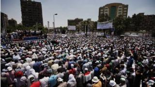 Egyptian Islamist groups led by the ruling Muslim Brotherhood take part in a demonstration to mark the upcoming one year anniversary since President Mohamed Morsi (portrait) was elected.