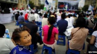 Mongolian woman attends pre-election rally in Ulan Bator June 20, 2013.