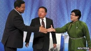 Tsakhia Elbegdorj (C), Badmaanyanbuu Bat-Erdene (L) and Natsag Udval at a television debate in Ulan Bator, 24 June 2013
