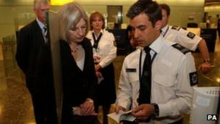 Home Secretary Theresa May meets passport officials at Heathrow in 2010