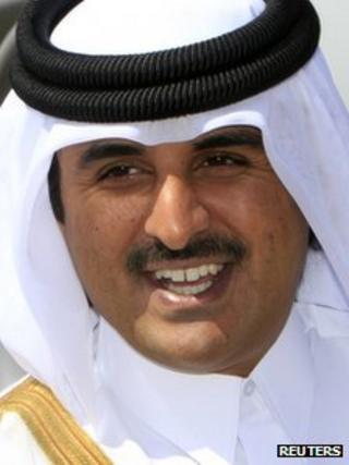 Qatar's Crown Prince Sheikh Tamim Bin Hamad al-Thani smiles during his arrival for a visit at Khartoum Airport, in this December 4, 2011 file picture.