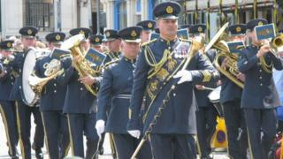 The RAF regiment band marching in the street