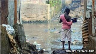 Child in an alleyway in Sierra Leone during cholera epidemic