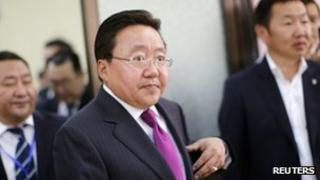 Tsakhia Elbegdorj arrives at a polling station to cast his vote during Mongolia's presidential elections in Ulan Bator, 26 June 2013