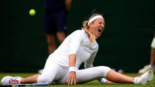 Victoria Azarenka falls during her first round match at Wimbledon
